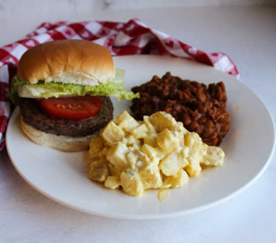 potato salad on plate with baked beans and hamburger
