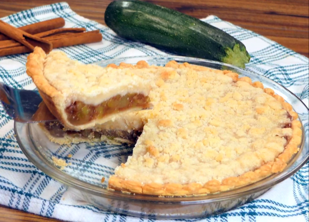lifting first slice out of sweet zucchini pie.