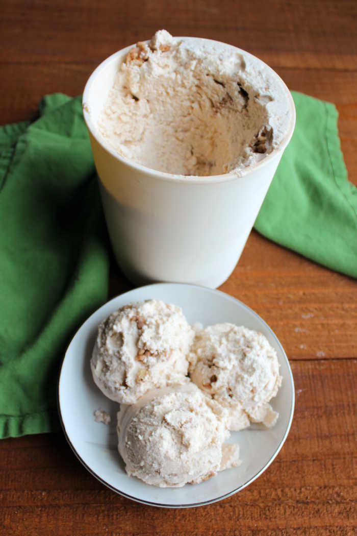 scoops of honey cinnamon ice cream with container nearby