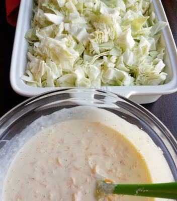 chopped cabbage and bowl of cheese sauce