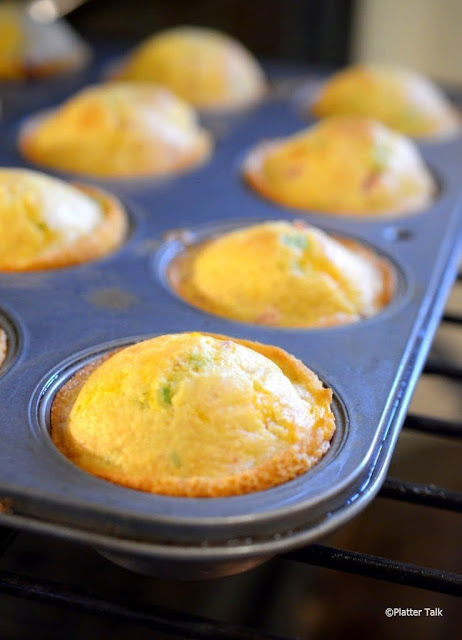 muffin tin filled with ham and cheese cornmeal muffins