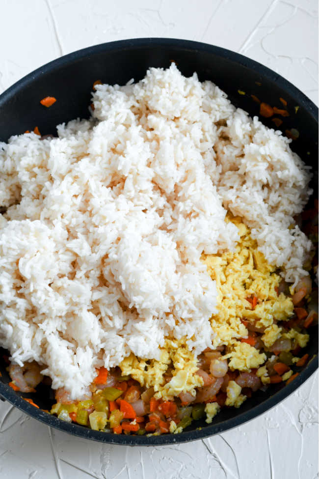 veggies, eggs and rice in skillet