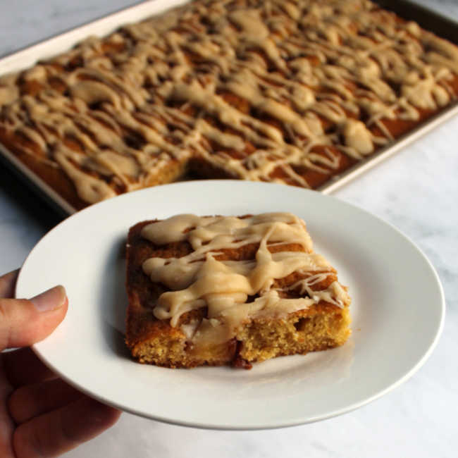 peach sheet cake drizzled with sweet brown butter glaze