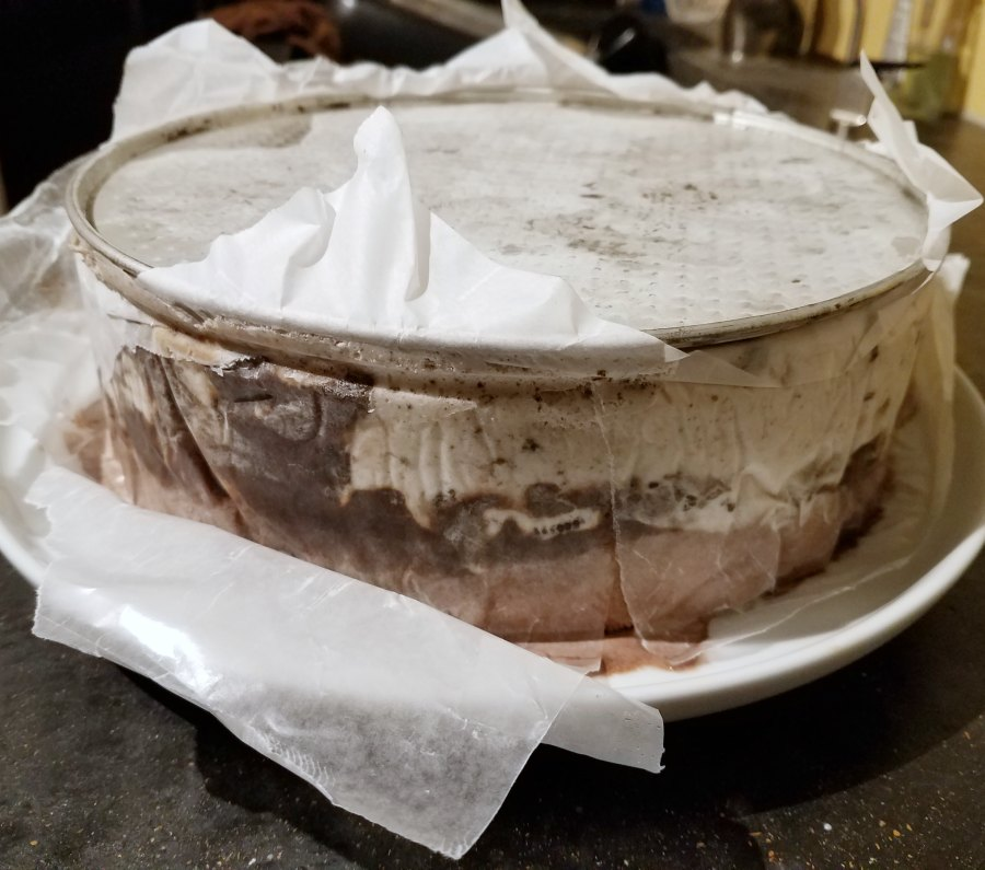 ice cream cake in the process of being demolded.