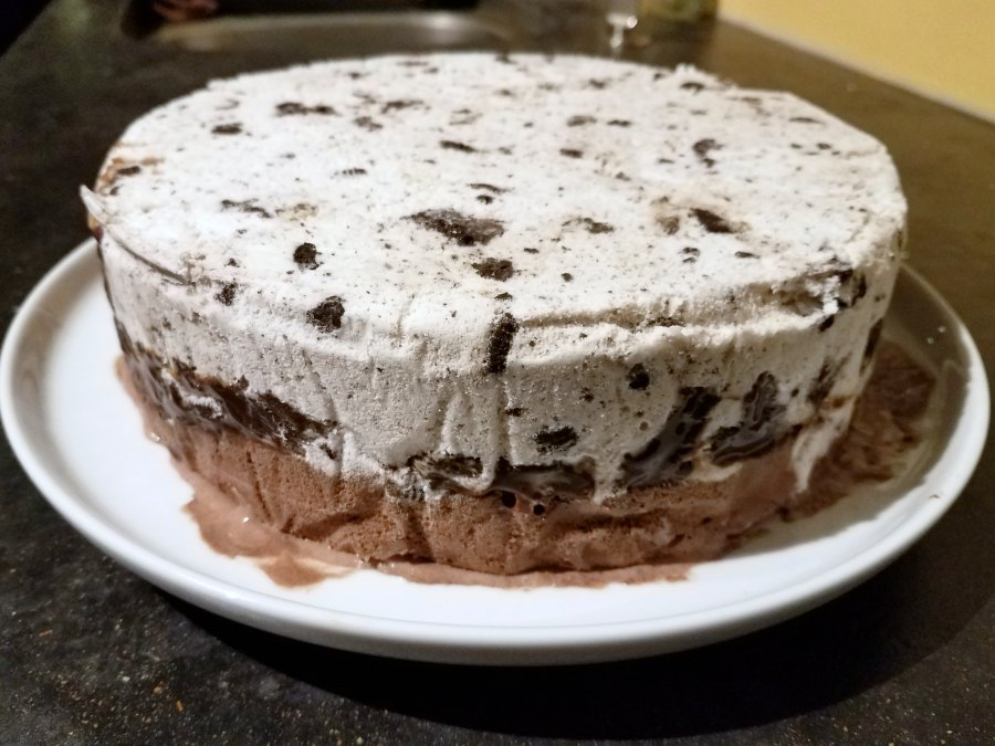 ice cream cake out of pan ready for whipped cream frosting.