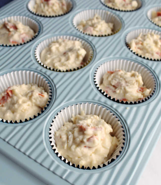 pepperoni muffin batter in tin ready to bake