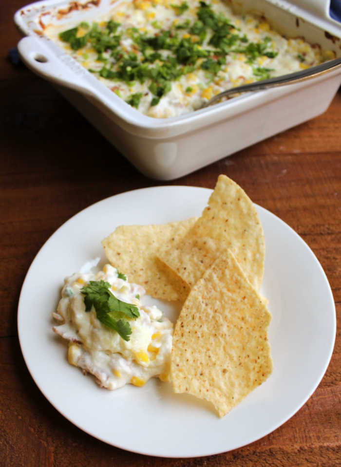 kickin' corn dip on plate with tortilla chips ready to eat.