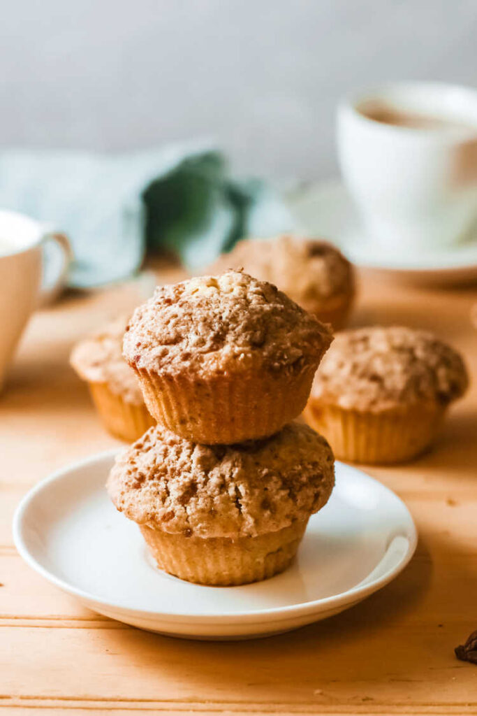 stack of streusel covered pumpkin muffins.