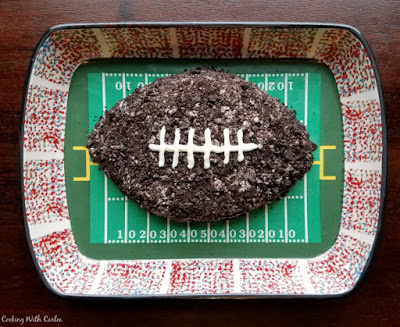 football shaped oreo dessert dip in football themed serving dish