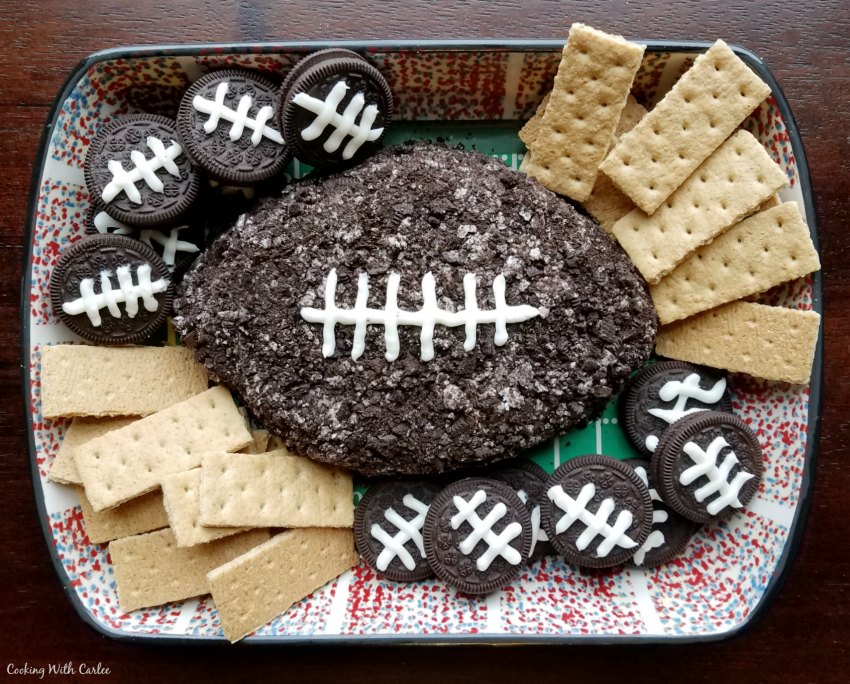 chocolate football shaped cheese ball with cookies for dippers