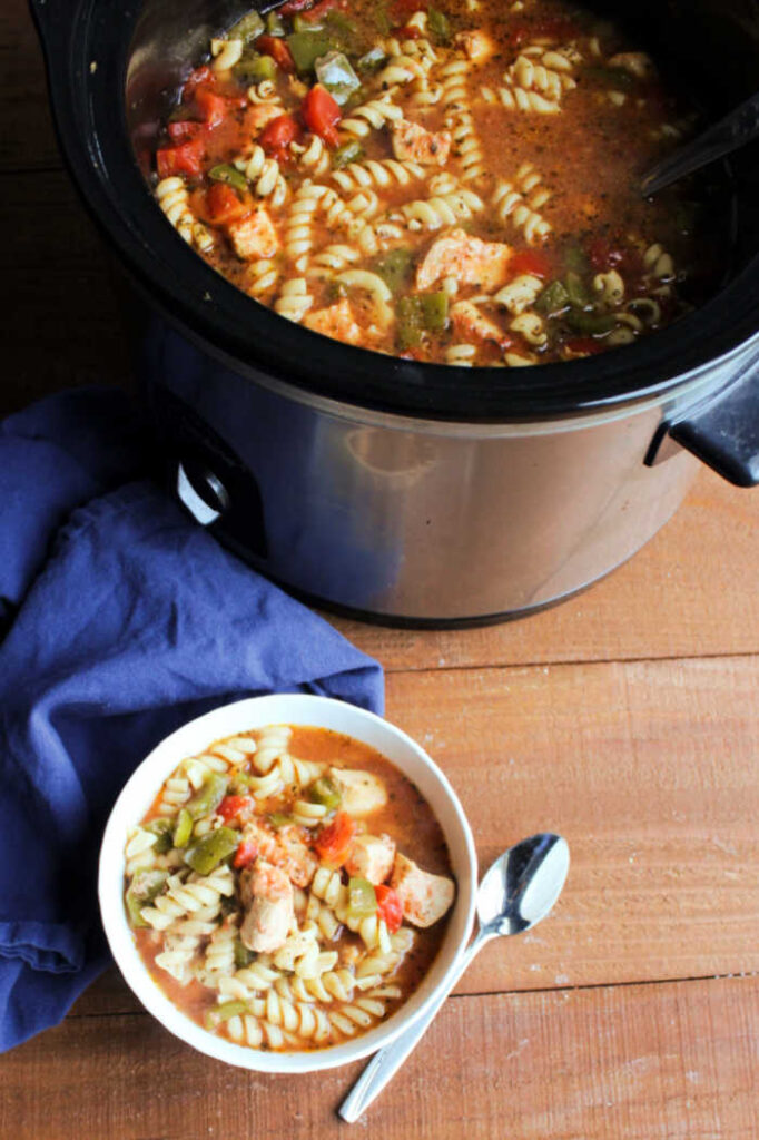 bowl of Italian chicken pasta soup by slow cooker.