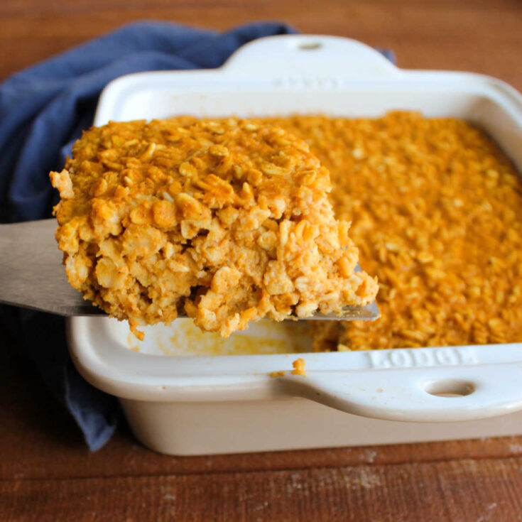 lifting out first slice of pumpkin baked oatmeal