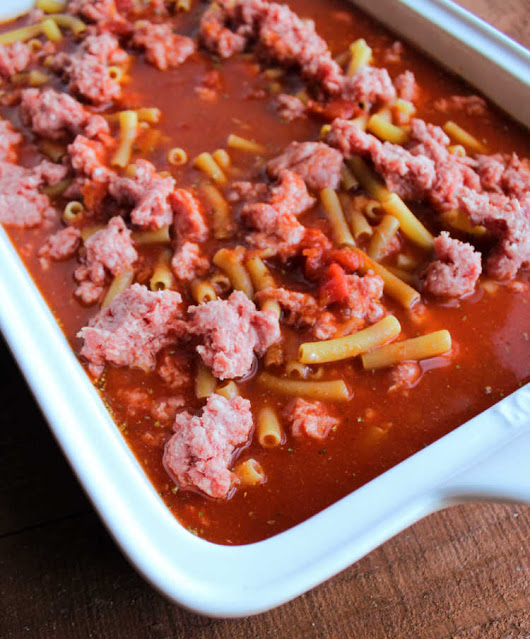 raw pasta and beef in sauce ready to bake