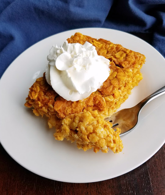 piece of pumpkin baked oatmeal with whipped cream