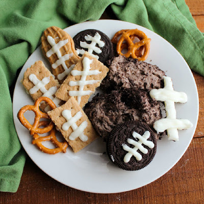plate of oreo cheese ball with cookies decorated with football laces