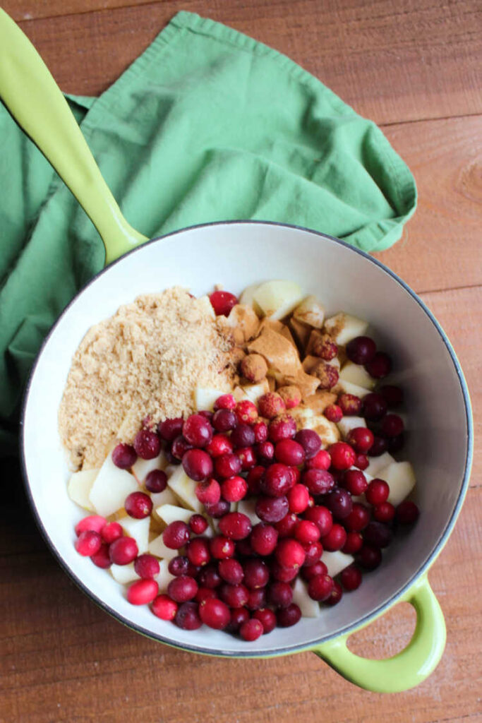 Cranberry applesauce ingredients in saucepan ready to cook