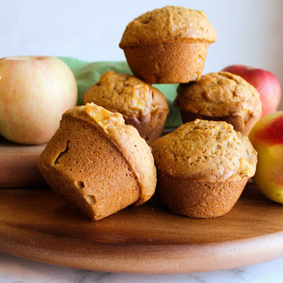 stack of pumpkin apple muffins on wooden board