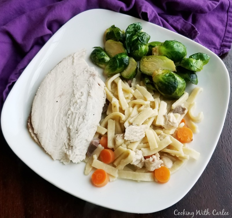 plate of homemade egg noodles, roasted turkey and brussels sprouts