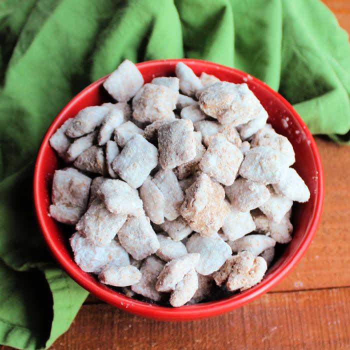 bowl of powder sugar coated muddy buddies ready to eat.