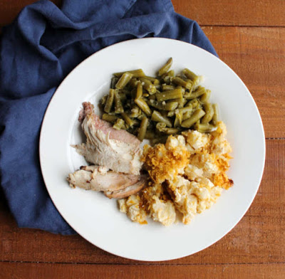 green beans, slices of grilled turkey and cheesy potato casserole on dinner plate