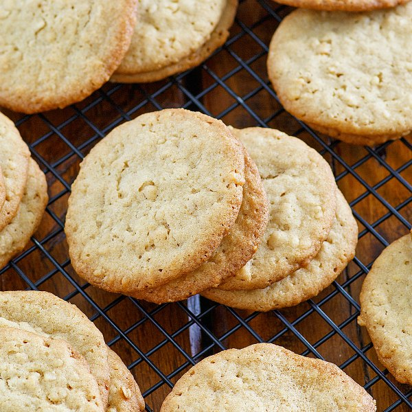 close up of buttery cuppa cookies with flecks of oatmeal and coconut showing.