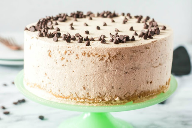 coffee sponge cake frosted with mocha whipped cream and topped with mini chocolate chips
