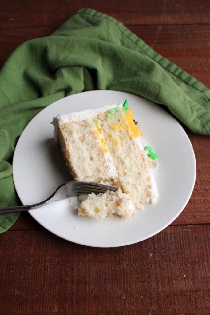 fork going in for bite of white cake.