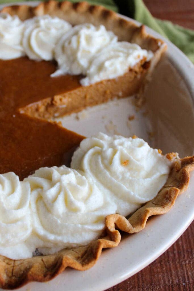 slice missing from sweetened condensed milk pumpkin pie.