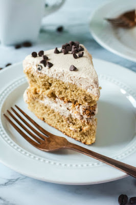 slice of layered coffee sponge with mocha whipped cream frosting