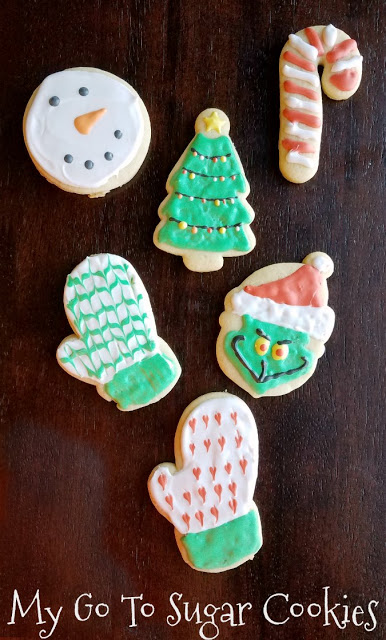 sugar cookies in Christmas shapes decorated with royal icing
