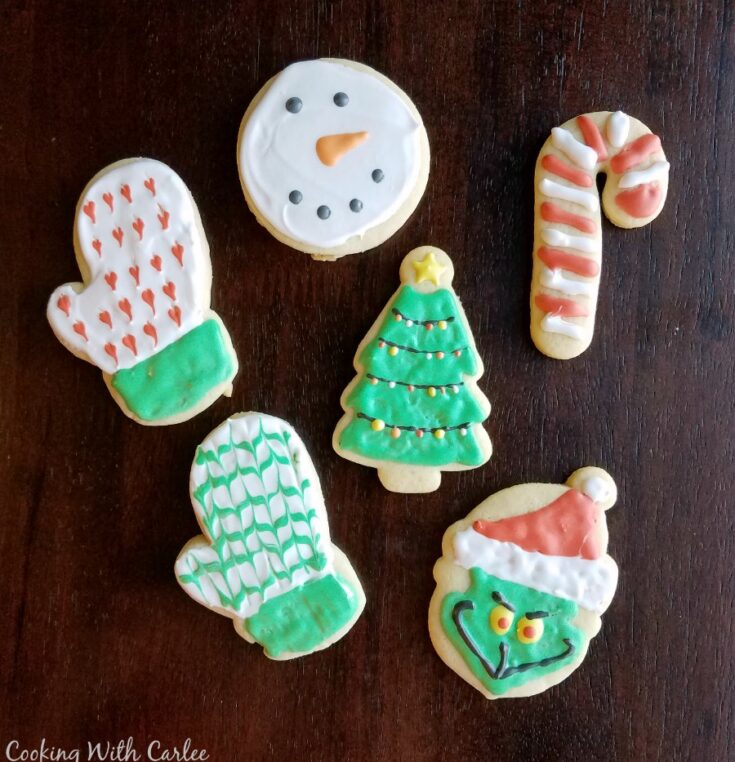 Go to sugar cookies cut into christmas shapes and decorated like mittens, the Grinch, a candy cane, snowman and Christmas trees with royal icing.