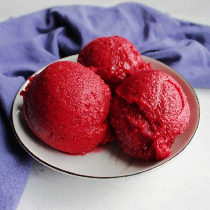 bowl of deep pink raspberry sorbet.