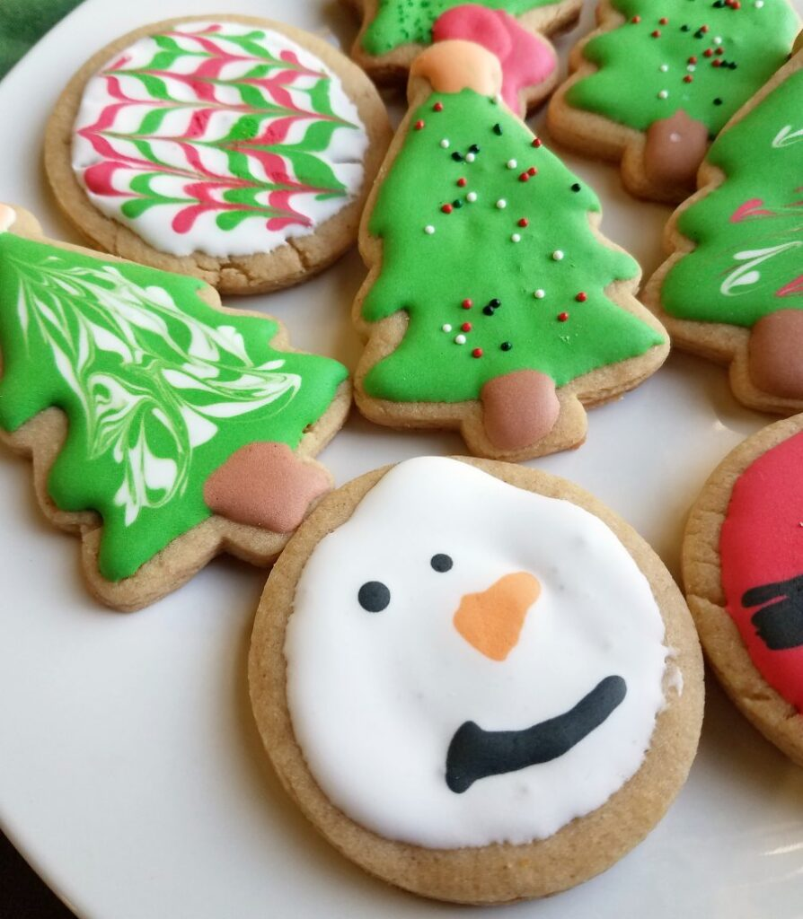 christmas peanut butter cookies decorated with royal icing.