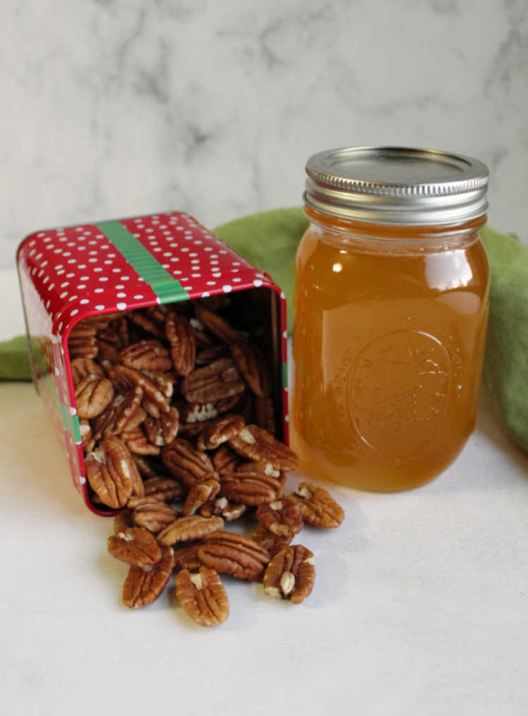 tin of pecans and jar of honey ready to be made into honey coated pecans.