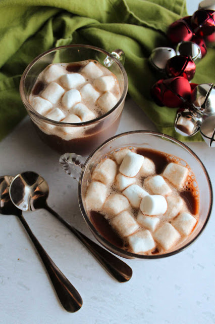 glass mugs of hot chocolate with marshmallows