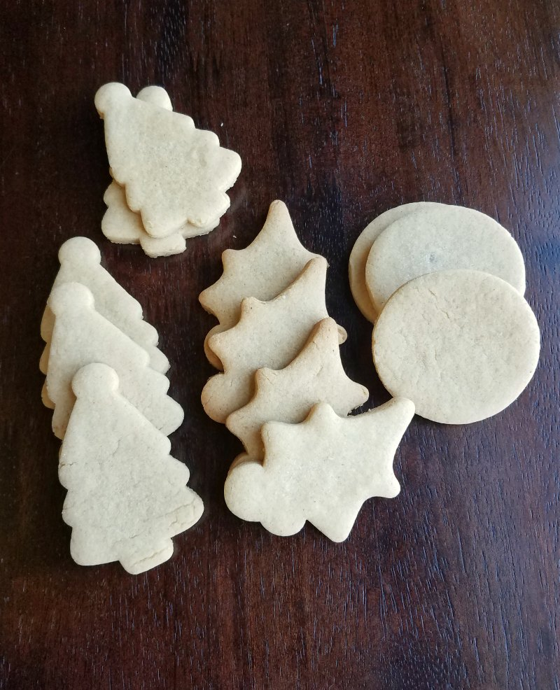 freshly baked peanut butter cookies in Christmas shapes.