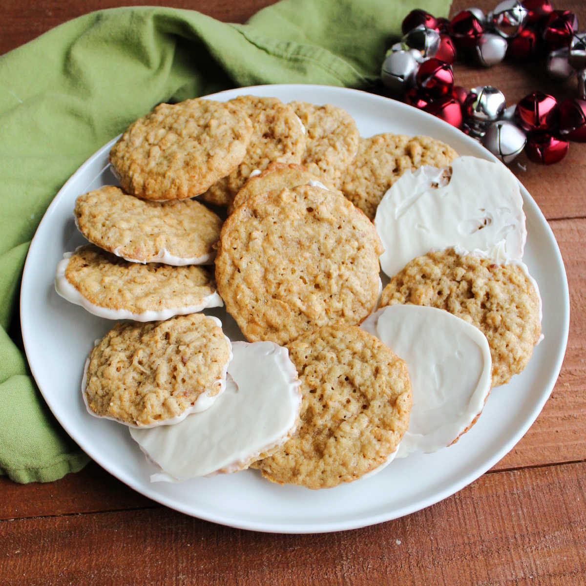 plate of oatmeal textured frostbite cookies with bottoms dipped in white chocolate