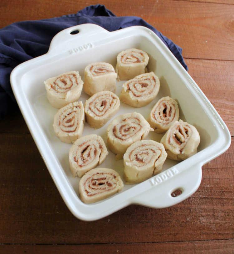 raw cinnamon butter roll swirls in pan.
