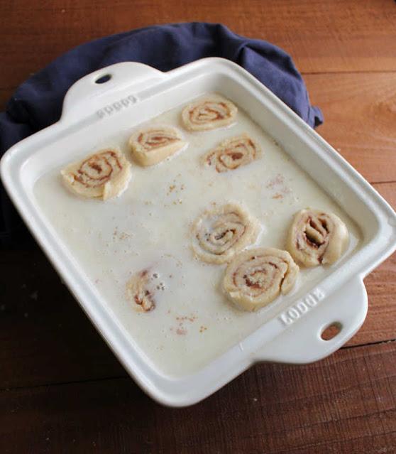 milk mixture and cinnamon rolls ready to bake
