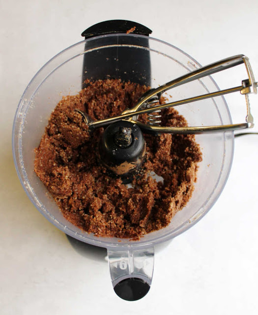 rum ball mixture and small cookie scoop in food processor