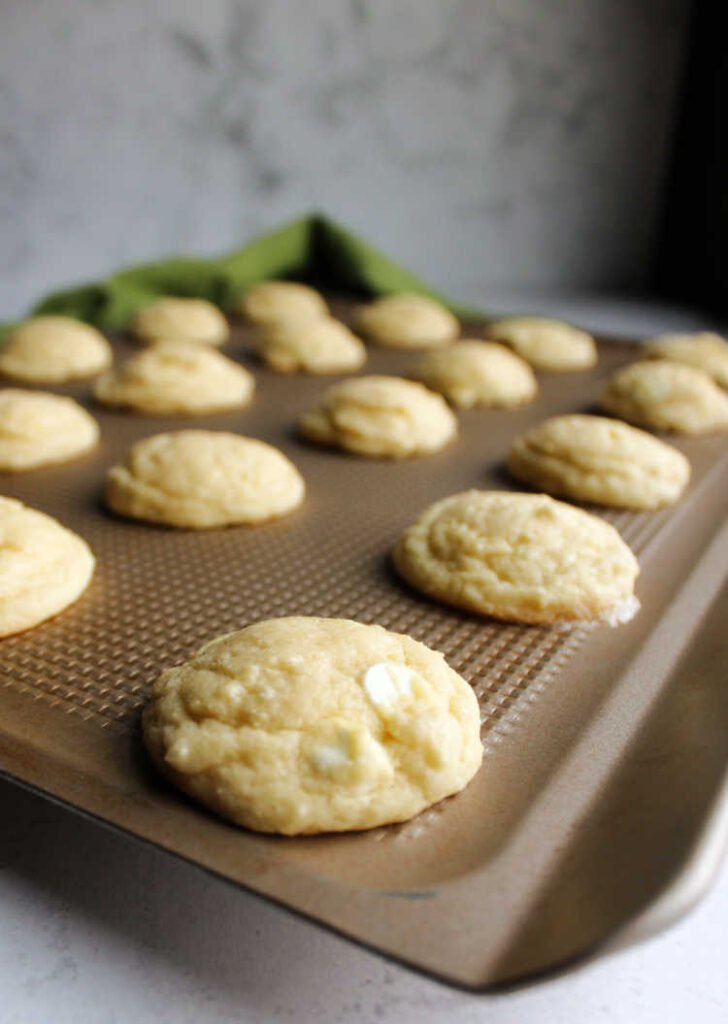 cookie sheet filled with freshly baked white hot chocolate mix cookies.