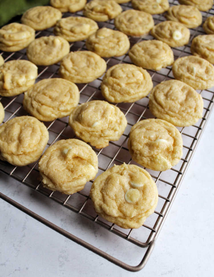 cooling rack filled with white hot chocolate cookies.