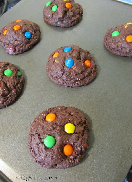 freshly baked chocolate m&m cookies on baking sheet