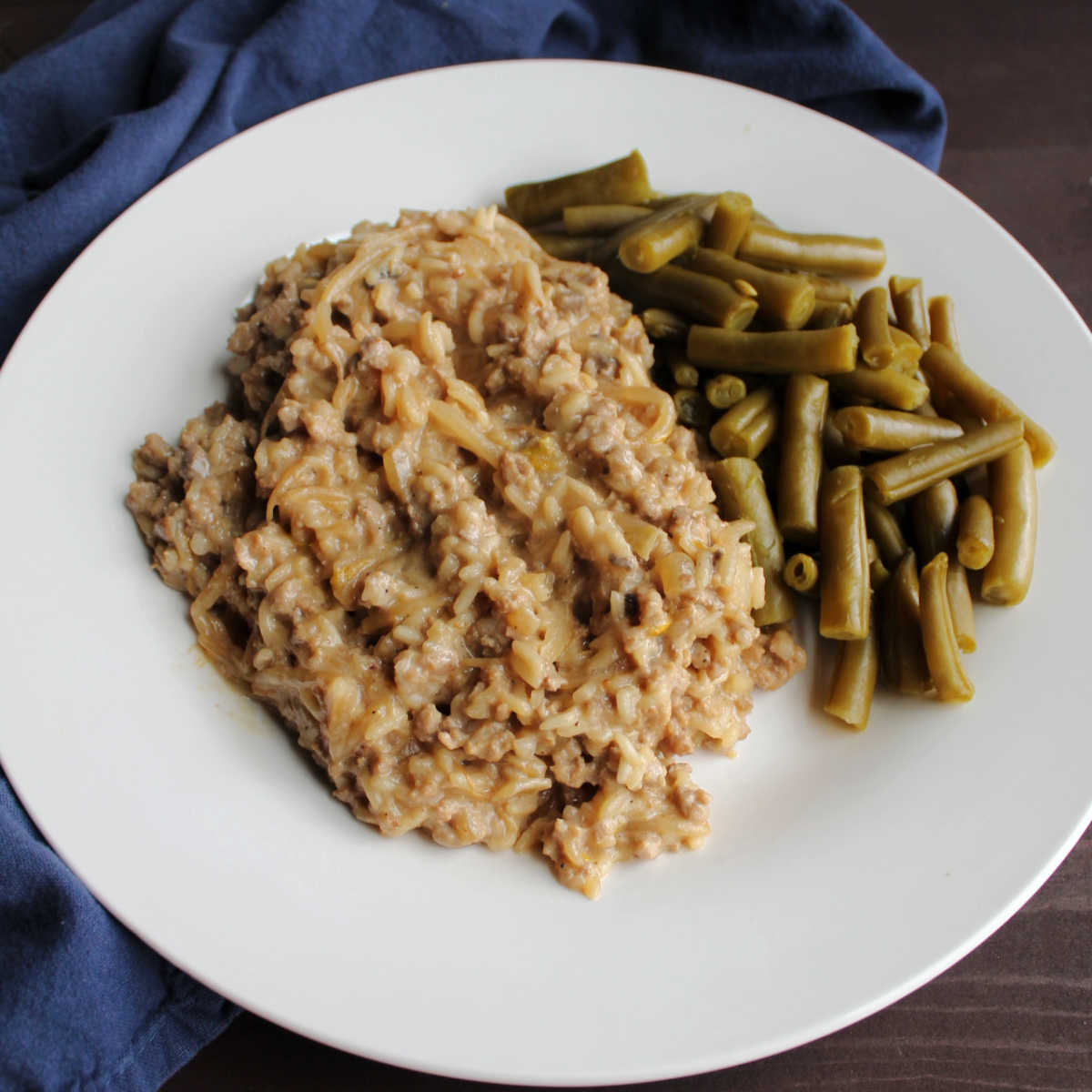 plate of creamy rice based pork chop suey and green beans ready to eat
