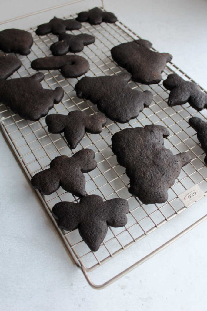 black chocolate cut out cookies cooling on wire rack.