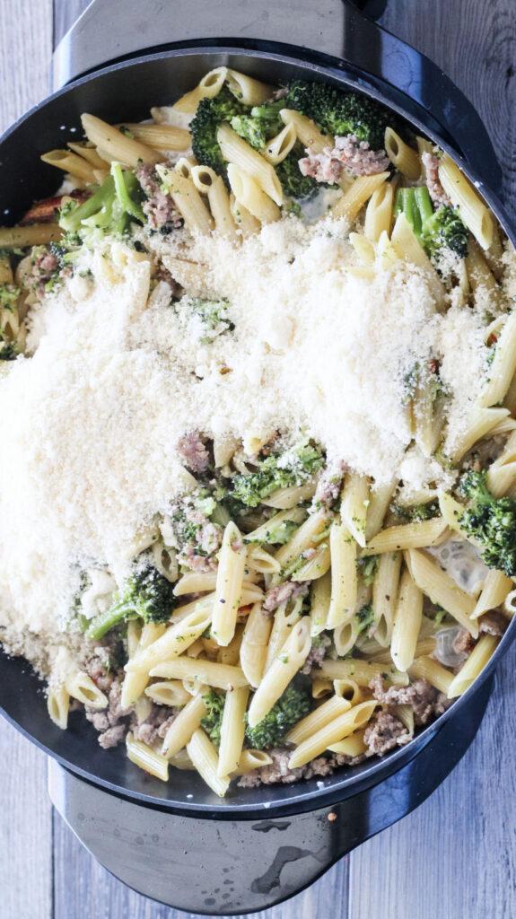 adding cheese to one pot sausage pasta