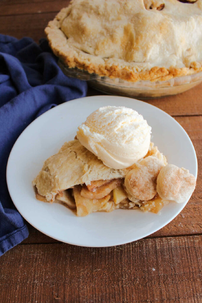 slice of apple pie with scoop of ice cream.