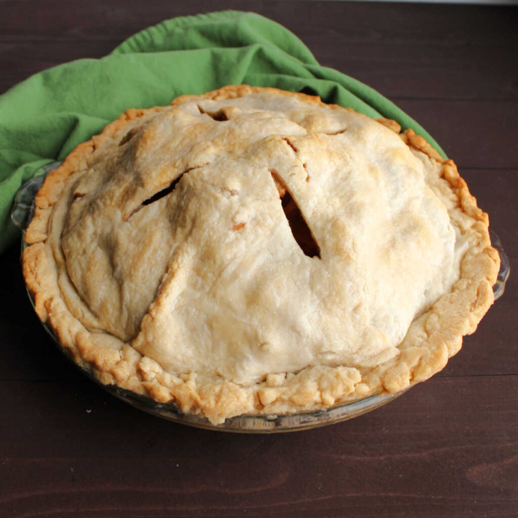 apple pie with golden homemade lard pie crust.