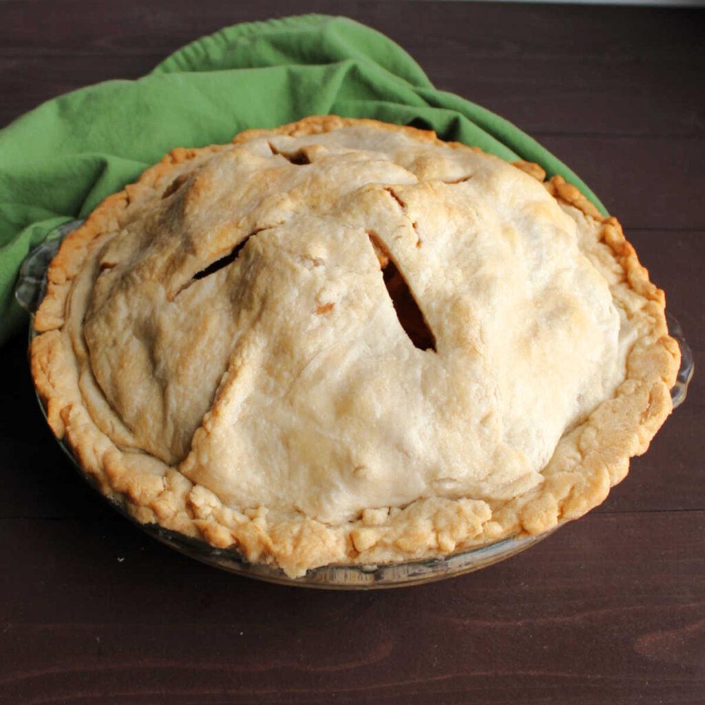 apple pie with golden homemade lard pie crust.