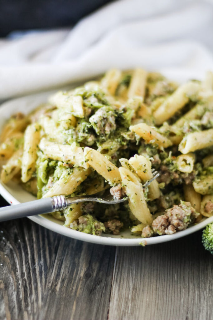 dinner plate with cheesy Italian sausage and broccoli one pot pasta